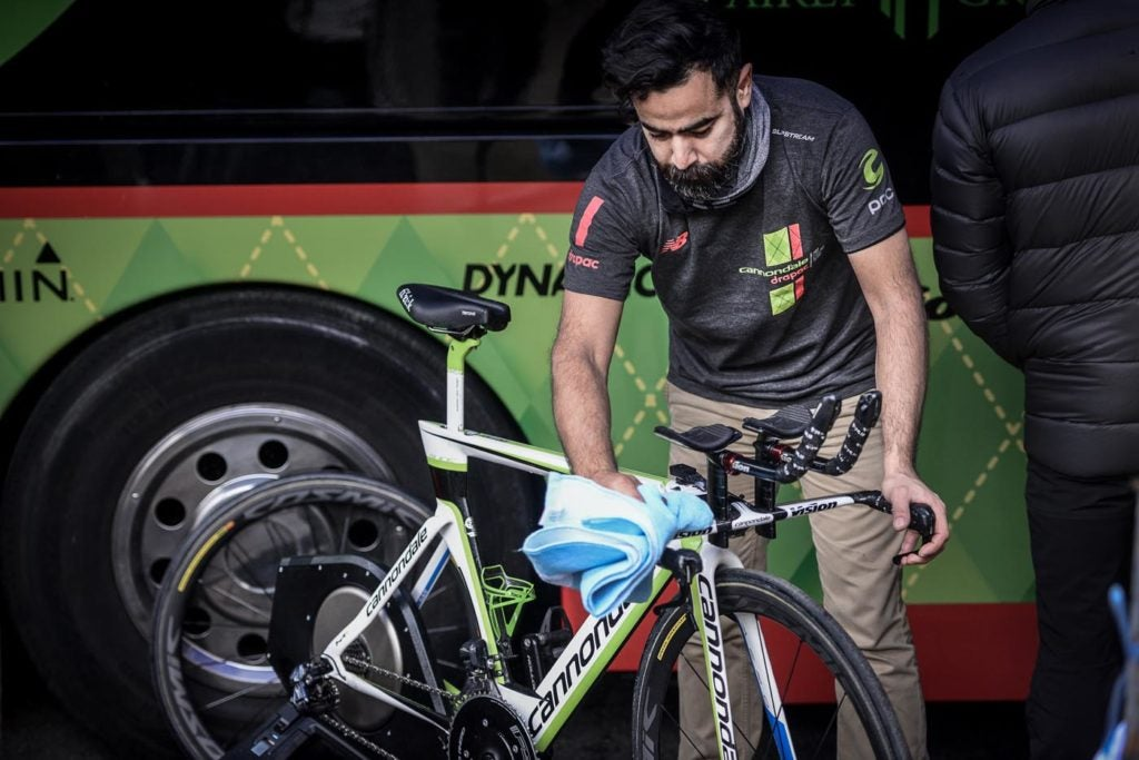 Keeping a bike dry is just one of many details a mechanic must attend to before a time trial in the rain.